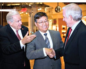 Chinese consul general: Liu Jian, pictured with South Coast Plaza Executive Director Werner Escher and General Manager David Grant, stopped in on diplomatic visit