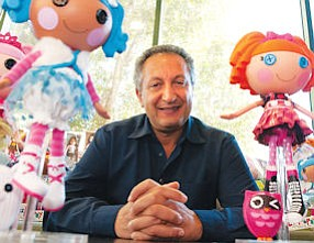 Evolution: Top, new Lalaloopsy baby dolls; above, Isaac Larian in file photo.