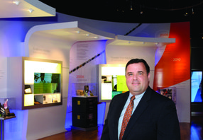 Qualcomm Inc. executive Bill Davidson sees the technology behind the company's proximity beacons as being able to virtually add to a retail store's sales staff.