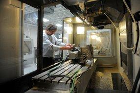 A NuVasive Manufacturing LLC employee works at San Diego-based NuVasive Inc.'s plant in Dayton, Ohio.
