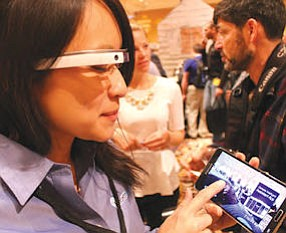 Google Glass demonstration: Evangelina La uses Hyundai's connectivity system, which remotely sends information to vehicles