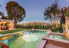 2 Windemere Court: Pebble Tec saltwater pool part of the appeal at Newport Coast home