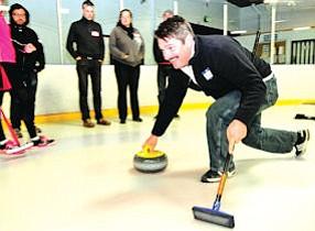 Cleaning Up: Curler Wim Bien displays proper form at practice.