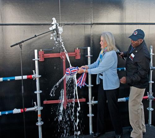 Lyn Glenn, daughter of John Glenn,  christened the ship, USNS John Glenn, at the General Dynamics NASSCO shipyard in San Diego.  Photo courtesy of PRNewsFoto / General Dynamics NASSCO