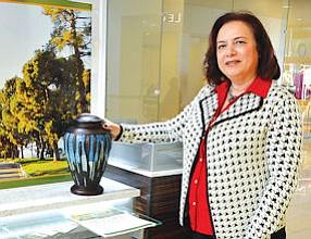 Retail Selection: Carmen Yaralian displays urn at Glendale Galleria.