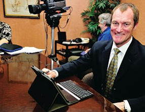 Raising the Bar: Encino attorney Adam Grant in room where video depositions are recorded.