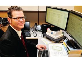 Signed On: Managing Partner Gregory Lampert at his Glendale office.
