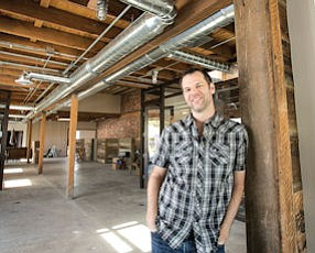 Perfect Fit: Tyler Bacon, president of Position Music, in his company's new creative offices at Mariposa Station.
