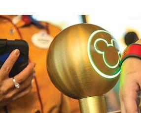Swipe It: Patron at Walt Disney World in Orlando, Fla. puts MagicBand to use.