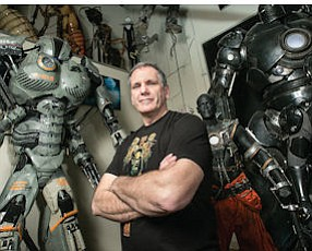 Ready for Battle: Alan Scott, cofounder of Legacy Effects, surrounded by models at the company's shop in San Fernando.