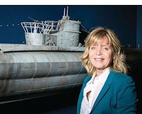 Diving In: Katherine McCune, owner of Grant McCune Design Inc., with scale model of a submarine at her firm's offices in Van Nuys.