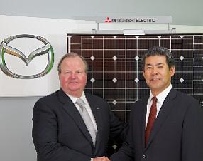 Jim O'Sullivan, president and chief executive at Mazda North American Operations, and Katsuya Takamiya, president and chief executive at Mitsubishi Electric U.S. Inc.