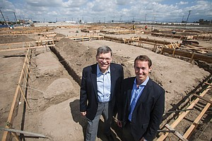 On the Ground: CEO John Huskey, left, and President Kasey Burke at Meta Housing Corp.'s apartment project in Vernon.