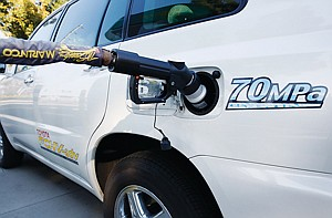 Filling Up: Toyota Highlander fuel-cell SUV charges at Fountain Valley station.