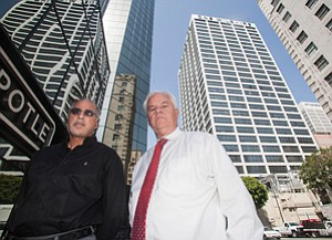 Business Links: Navroz Haji, left, and Max McCombs across from One Wilshire building.