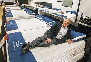 Cushy Job: Earl Kluft with E.S. Kluft & Co. mattresses at a Bloomingdale's in Century City.