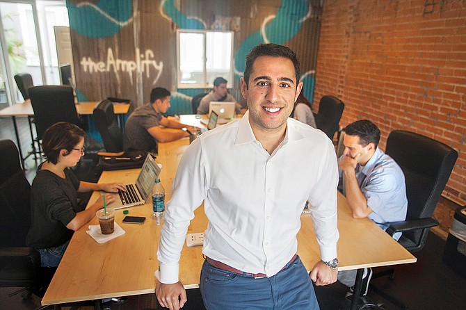 Raising Voice: Justin Rezvani, chief executive of theAmplify, at the firm's Culver City offices.