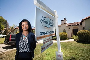 Putting Out Welcome Mat: Heyler Realty co-owner Jae Wu at a Westside home listed for about $1.2 million.
