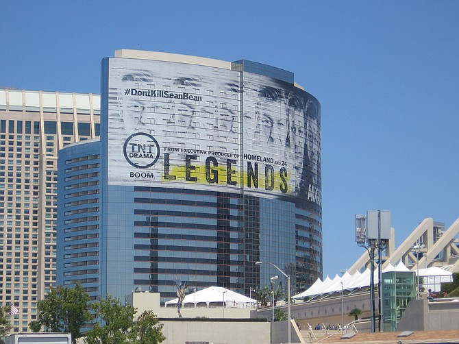 High above the convention center, a multi-story ad on the exterior of San Diego Marriott Marquis & Marina hotel touts TNT's drama Legends. Photo by Lou Hirsh