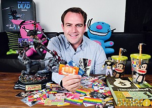 Card Carrying: Ben Katz at Card.com's Brentwood office with some of the company's cards featuring brands such as Garfield and comic-book Walking Dead.