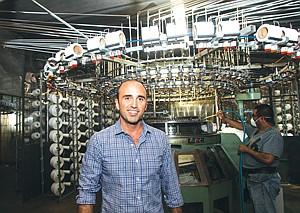 Sewn Up: Chief Executive Sean Sassounian at SAS Textiles' factory in Vernon.