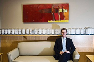 LINING IT UP: W. Hunter Stropp, at Westwood office of THL Credit Inc., with row of 'tombstones' representing deals the firm has done.