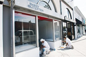 Taking Shape: Workers prepare AwesomenessTV's pop-up shop in L.A.'s Fairfax District for an opening next month.