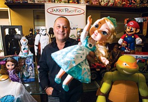 Page 6: Stephen Berman with Frozen Snow Glow Elsa doll at Jakks in Malibu.