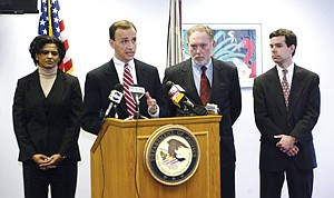 On case: Medbox board member Jennifer Love, left, at a 2003 press conference in Baltimore during her two-decade career in the FBI.