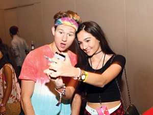 Online Attraction: YouTube star Ricky Dillon, left, with a fan at Fullscreen's InTour show at the Pasadena Convention Center in September.