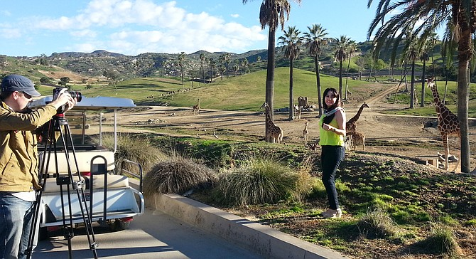 Brand USA videographer Tory Nelson and on-camera host Vange Tapia shoot a promotional video at San Diego Zoo Safari Park near Escondido. Photo courtesy of Brand USA