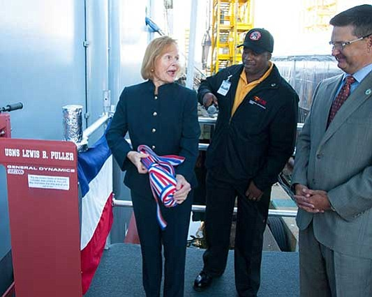 Martha Puller Downs prepares to christen the USNS Lewis B. Puller named in honor of her father. Photo Courtesy of General Dynamics Nassco