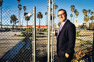 Gated: Councilman Bob Blumenfield at weed-strewn lot at center of his Reseda renewal plan.