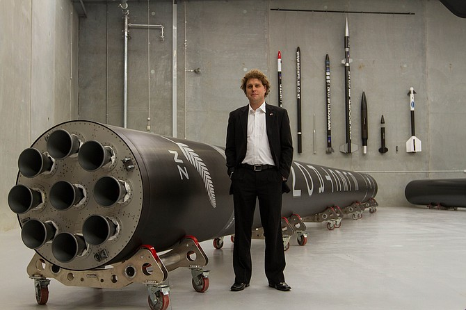 Chief Executive Peter Beck with the Electron launch vehicle. (Rocket Lab)