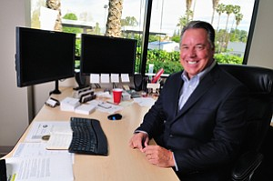 All Smiles: Jim Scanlon at the offices of SGB-NIA, now owned by Arthur J. Gallagher.