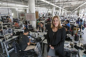 Stitched Together: Paula Schneider at the downtown L.A. headquarters of American Apparel, which has undergone recent changes to upper management.