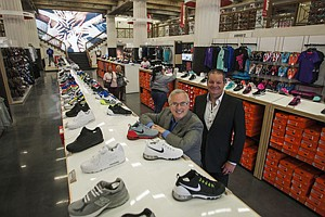 Best Foot Forward: Mark Archer, left, and Dan Nuthals at Warehouse Shoe Sale's new flagship store in Westlake.