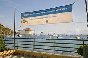 Sign of Time: Banner at Catalina Bay reminds visitors of drought restrictions.