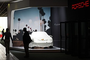 On Duty: Security guard stands watch before a Porsche exhibit the L.A. Auto Show at the Los Angeles Convention Center in November 2013.