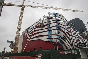 Getting on Track: Workers revamp the exterior of Petersen Automotive Museum in Miracle Mile.