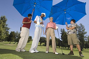 Snoop Dogg, left, and Lee Iacocca as golfers in a Chrysler ad.