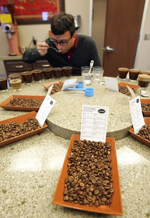 Tasty: A Farmer Bros. tester samples product in 2012.