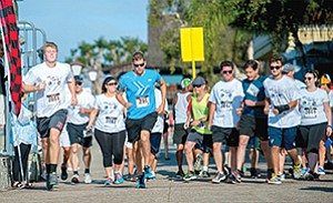 Employees of CUSO Financial Services and Sorrento Pacific Financial participate in a 5K to benefit the Wounded Warrior Project.