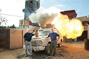 Producer Stu Segall, left, and Kit Lavell, executive vice president of Strategic Operations, demonstrate a simulated explosion used as part of a training program to prepare civilians and military personnel for high-stress, traumatic situations.