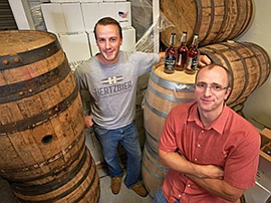 Nick Walmsley, left, and Matt Wrosch, co-founders of Hertzbier, are testing their barrel-aging technology at Liberty Call Distilling Co. in Spring Valley.