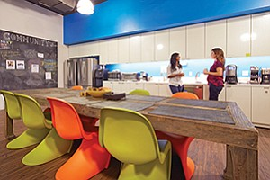 A fully-stocked kitchen with plenty of seating, as shown here at BIOCOM, can encourage workers to congregate during lunch breaks rather than leave the office to eat alone.