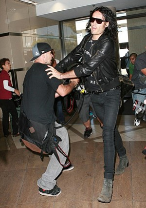 Star Sighting: Russell Brand clashes with photographer at LAX in 2010.