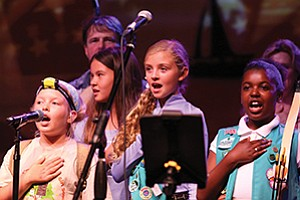 Girl Scouts Sophia Benito, Kalea Scott, Joelle Vitiello and Shalene Bryant lead the Pledge of Allegiance at the 18th annual Urban Campout fundraiser. 