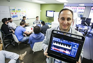 Heady Investment: Leo Petrossian with a diagnostic device at Neural Analytics' headquarters in West Los Angeles.