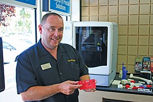 Burke Jones, UPS franchise owner, was one of several stores in San Diego that began offering 3-D printing services. Photo courtesy of UPS